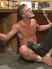 Christian Wilde just finished a long graveyard shift, and now he needs to unwind. Lucky for Christian, he has a plaything awaiting him in his dingy apartment-- Alexander Gustavo, locked in a chest. Christian wrests the abducted stud out from the chest and binds him to a cabinet. Alexander tries to resist the torment as Christian torments his vulnerable body. Christian painfully twists his prey's nipples and crushes his balls with work boots before bringing out a taser, zapping Alexander's pecs and balls. After a deep face fucking, Christian tears Alexander's nerves to shreds as he traces a cattle prod around his balls before delivering a cruel shock of electricity. Next, Christian ties Alexander over his bed posts where he takes brutal whipping and flogging. Christian then ravages Alexander with a fucksaw, pulling the trigger to full power. Now with Alexander's hole prepared for Christian's massive cock, Alexander takes a mean fucking over a web of ropes.