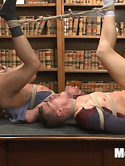 JJ Knight and Jett Jax got caught cheating on their midterms, so Professor Forrest drags the boys into the headmaster's office. With no tolerance for cheating, Headmaster Keys pulls out a rope from his desk and promises an ample punishment for the boys. Jett and JJ find themselves bound together at the neck as their administrators strip the boys and inspect their cocks. The punks moan in unison as they're edged repeatedly, sucking their hard dicks and working them tender with fleshjacks and vibrating cock sheaths. The professors flip the boys' legs up and jam dildos far up their asses. The pressure on their prostates feels unbearable to Jett and JJ, who suffer through the intense pleasure without an orgasm. Now standing in rope harnesses strung from the ceiling, the boys have their nipples, pits and toes worshipped as Mr. Keys and Mr. Forrest trade off on double blow jobs before allowing them both to blow their load. With their faces covered in their own cum, the two delinquents endure an excruciating tickling to ensure they'll never cheat again!