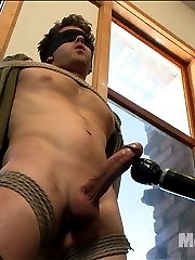 Straight stud Wolf is brand new to KinkMen.  He's let his girlfriend handcuff him before but he's never been in full bondage.  Wolf is very nervous about letting a couple of guys stroking his cock. Before the edging can begin, we tie his hands behind his back and blindfold his eyes so he can focus on every sensation.  It doesn't take this stud long before his big hard cock is bulging out of his underwear.  Edging Wolf's cock is like walking in a mine field, you just never know when he's about to blow.  We give him a taste of the flogger before he's suspended in the air with his giant cock hanging down.  Tied down to the bed, we milk a load out of Wolf's throbbing cock before giving him some post orgasmic torment.  Covered in his own cum, we finish him off by tickling the hell out of him till he screams for mercy.
