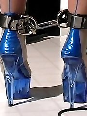 Cute bigtitted slave in sexy latex stockings and dress gagged and restrained for bad attitude
