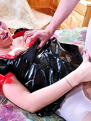 Sassy girl putting on her PVC nurse uniform and white pantyhose for a bang