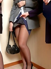 Luscious chicks in control top pantyhose playing with sex toy in lez 3some