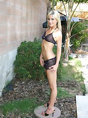 Leggy blonde Courtney goes outside to show off her ruffled black and pink panties