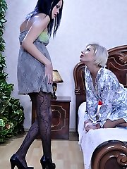 Lesbian dolls in fashion and sheer pantyhose lick slits and use a strapon