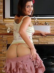 Naughty teen doll flashes a hot red thong under her trendy green pantyhose