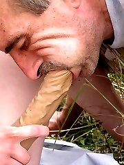 Outdoors strapon male slut