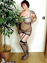 Busty tattooed whore strips out of her fishnet dress and stockings