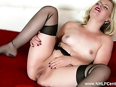 Naughty blond Anna Belle wanks in retro garter and sheer ebony nylons