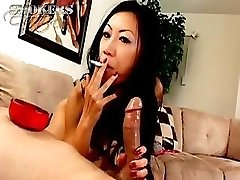 Tia Ling loves to gargle on a cigarette and a hard penis at once