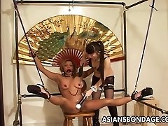 Restrained Asian doll tormented by her smoking molten mistress