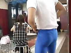 Muscular guy demonstrates very cute busty Japanese chick in a bar