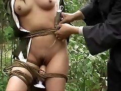 Chinese army girl strapped to tree 3
