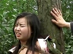 Chinese army gal tied to tree 2