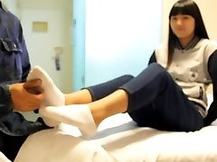 asian tickle woman with sock and bare