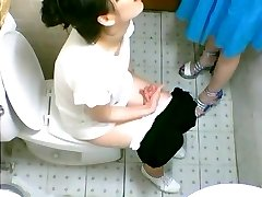 Two cute Asian girls saw on a toilet cam urinating