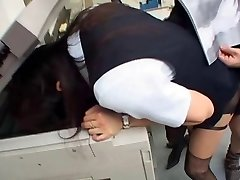 Jap lady romps in the office with head in the photocopier