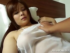 Japanese AV Model is a hot milf in transparent lingerie