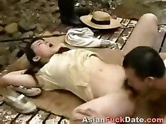 Horny Chinese husband and wifey duo get frisky in the woods