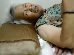 Chinese Granny With Excruciating Orgasm