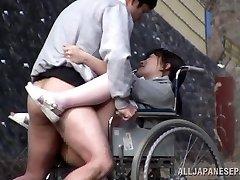 Horny Asian nurse sucks cock in front of a voyeur