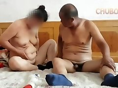 Chinese grandpa providing it to grandma from behind