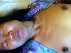 Ugly asian cunt lies on bed