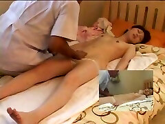Bony young Chinese chick lays on the bed and gets a nice relaxing massage