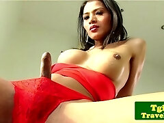 Ladyboy jerking cock and showing bum off