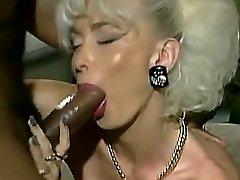 Vintage Busty platinum blond with 2 Big Black Cock facial
