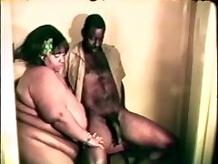 Big fat hefty black whore enjoys a hard black cock between her lips and legs