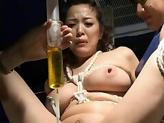 BDSM: Japanese w catheter drained and re-filled