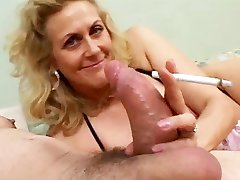 Smoking Mature Gives Blowjob To A Giant Wood