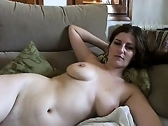 Busty mature brunette with huge boobs and unshaved twat strips