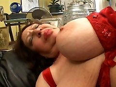 Fat mature sucking on String-on