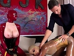 Two latex-loving bitches share a big spear