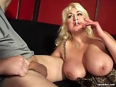 Huge-titted mom gives blowjob and smokes ciggy