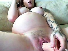 Pregnant brunette slutty masturbates with huge dildo