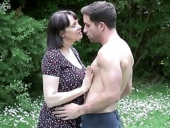 Big breasted Brit Mummy fucking not her son
