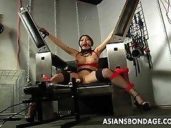 Busty brunette getting her wet vulva machine fucked
