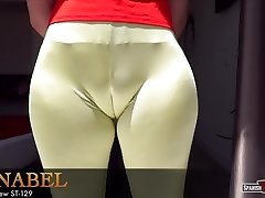 Curvy teenage ambles down the street flaunting cameltoe