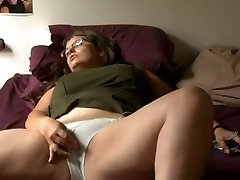 BBW lady with glasses masturbates