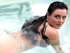 Big breast brown-haired plays in water