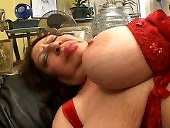 Fat mature sucking on Strap-on