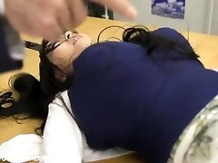 Giant busty asian babe toying with men at the office