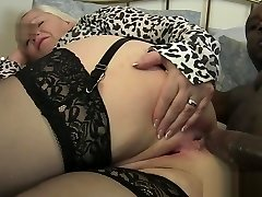 Old female takes it in the ass by black cock