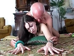 Slut demonstrates dildo to older man