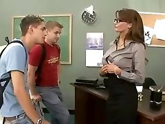 Busty brunette teacher plows and sucks her two students in threesome