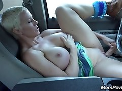 Big breast MILF masturbates in car