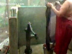 huge luxurious woman indian bhabhi taking shower from pump