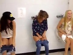 3 teens have fun on mans bathroom